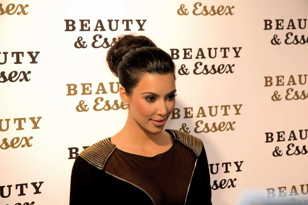 Kim Kardashian gathered her thick black hair into a braided bun during the opening of Beauty & Essex at the new downtown restaurant from Rich Wolf, Peter Kane, and Chris Santos on December 10, 2010.