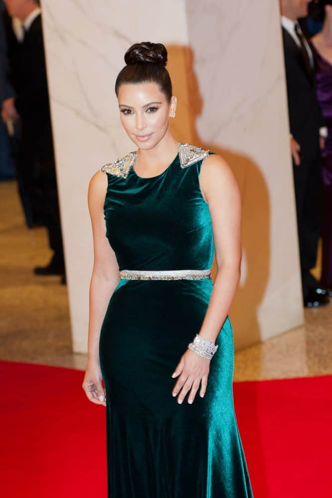 Kim Kardashian overflowed with posh and class in a green velvet gown along with a braided top knot at the White House Correspondents Dinner held last April 28, 2012.