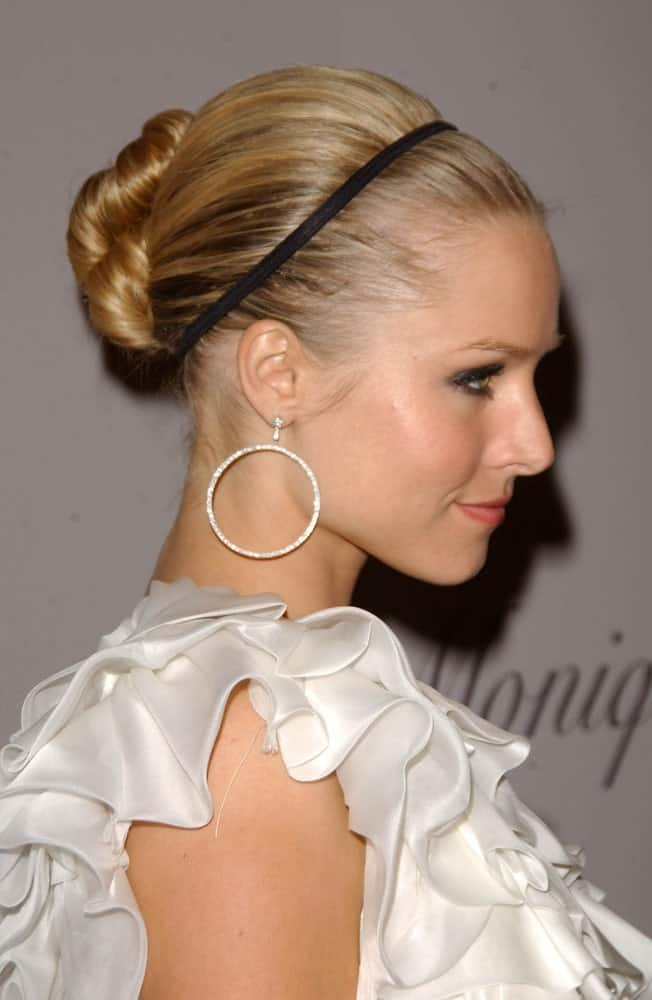 Kristen Bell wore her slicked bun with a headband last October 10, 2007, during the Grand Opening of Monique Lhuillier's New Boutique. She finished the look with hoop earrings and a white ruffle dress.
