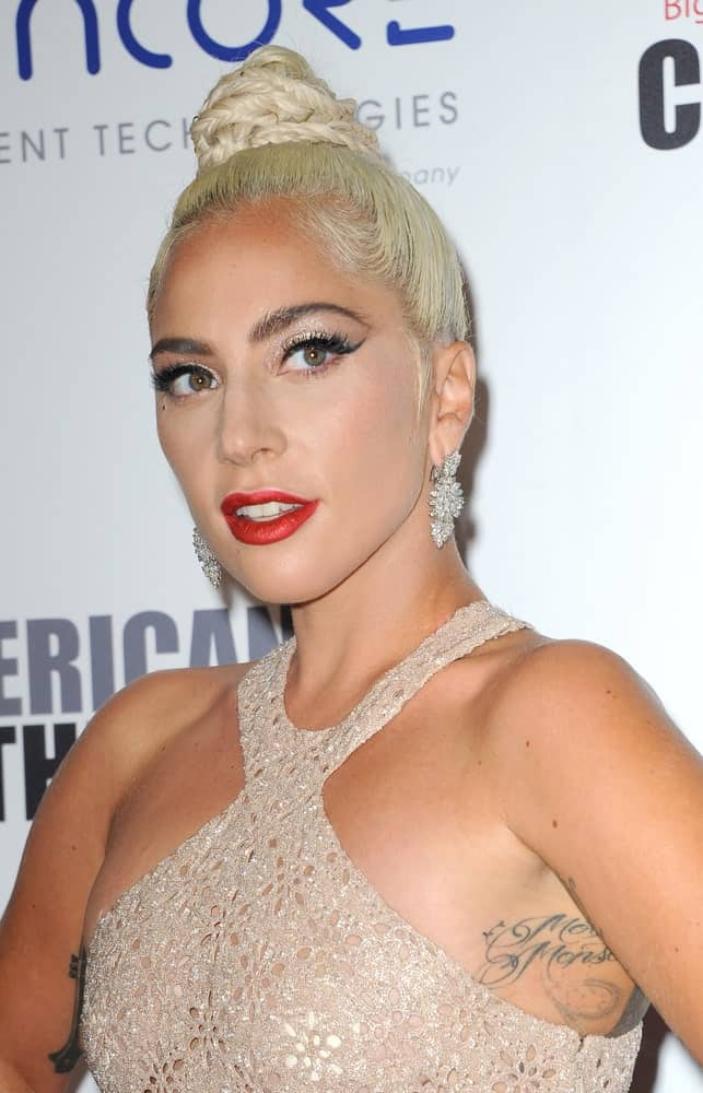 Lady Gaga was quite stunning in her sexy sheer dress and her slick top knot hairstyle that has small braids at the 32nd American Cinematheque Award Presentation Honoring Bradley Cooper held at the Beverly Hilton Hotel in Beverly Hills on November 29, 2018.