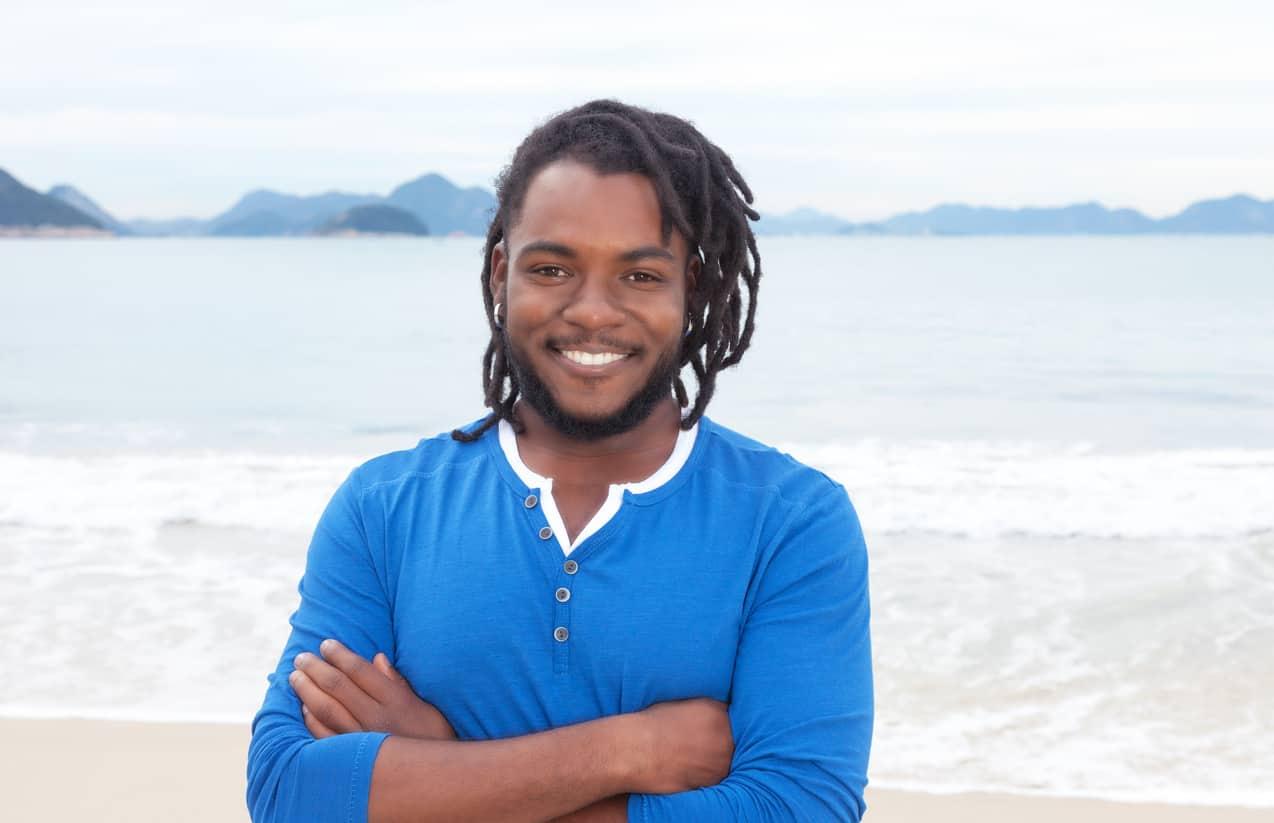 Man with dreadlocks on the beach