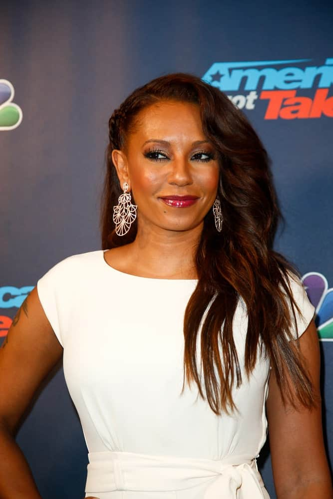 """Mel B complements her voluminous side-swept hair with braids on the other side during the post-show red carpet for NBC's """"America's Got Talent"""" Season 8 on August 28, 2013."""