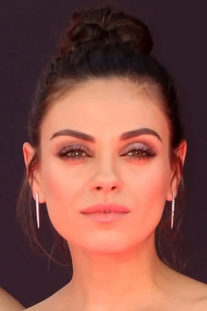 Mila Kunis wore her brunette hair in a gorgeous top knot with a few tendrils on the sides framing her face during the Billboard Music Awards 2016 last May 22, 2016.