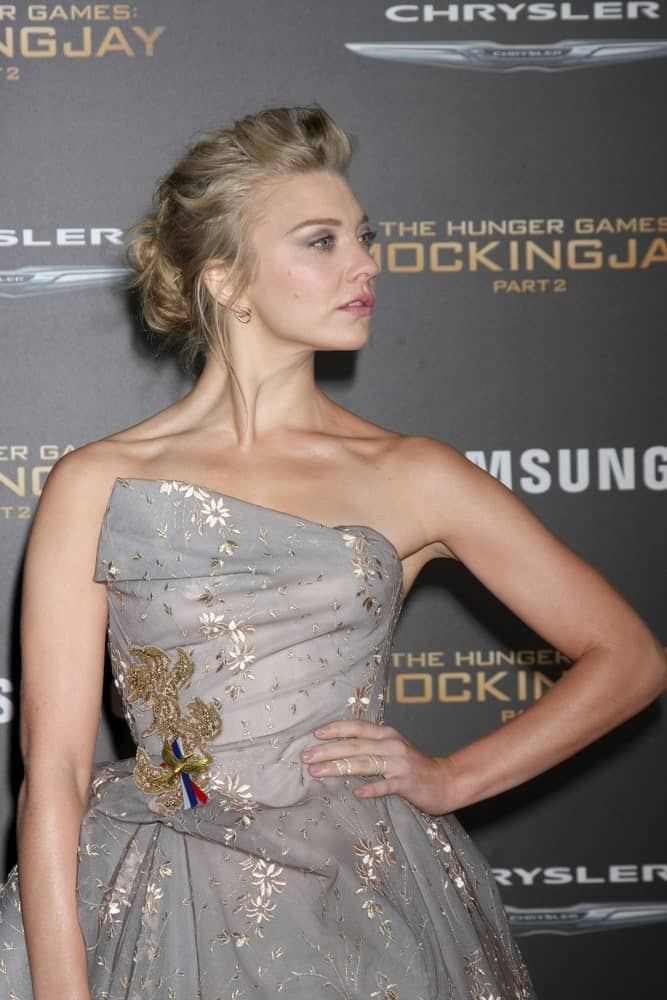 "Natalie Dormer looked gorgeous in a silver printed dress along with a glam messy updo that she flaunted during the ""The Hunger Games -Mockingjay Part 2"" LA Premiere at the Microsoft Theater on November 16, 2015."