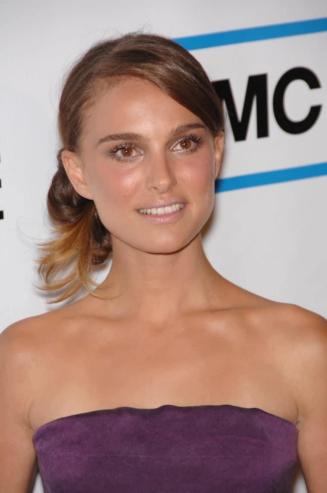 A slightly bronzed Natalie Portman wore a strapless dress and a messy low bun hairstyle with side-swept bangs at the American Cinematheque Gala at the Beverly Hilton Hotel on October 13, 2007, in Los Angeles, CA.
