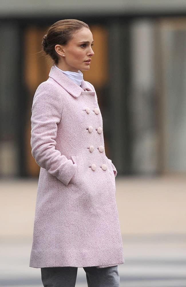 Natalie Portman was seen on location for BLACK SWAN Film Shoot in Manhattan, Lincoln Center, New York, NY on December 7, 2009. She was seen wearing a beautiful long coat that she paired with a neat bun hairstyle with a slick finish.