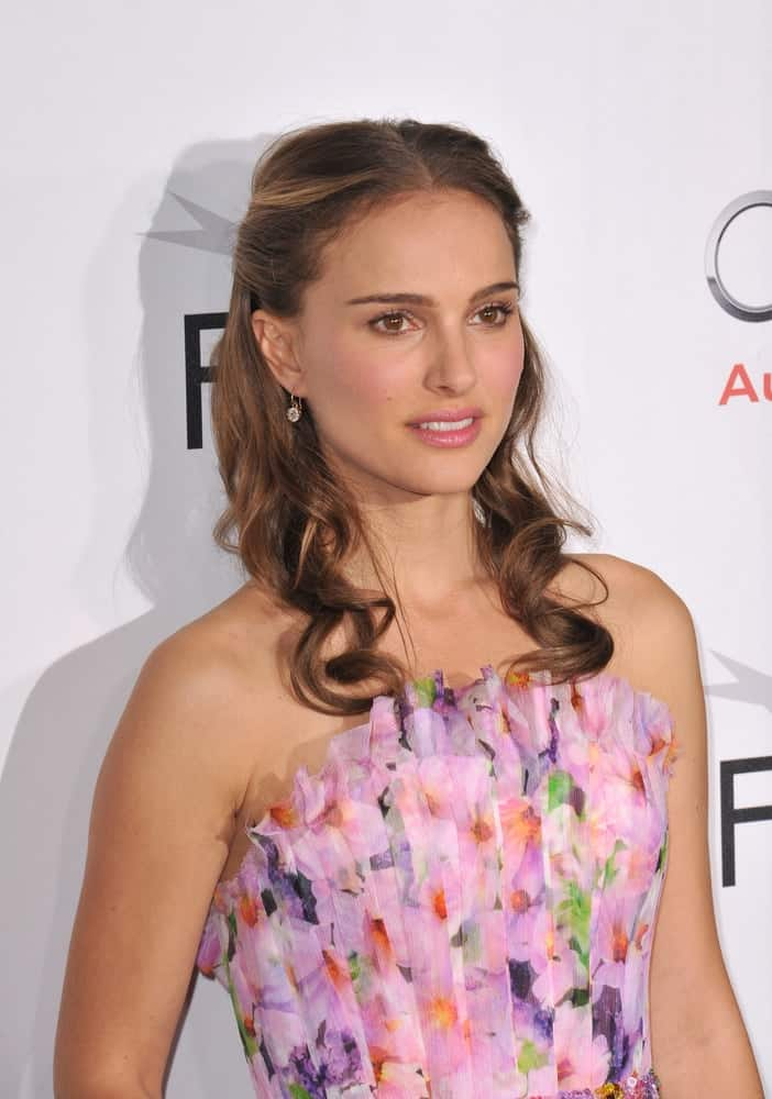 """On November 11, 2010, Natalie Portman paired her gorgeous floral dress with a half-up hairstyle that has curly tips at the Los Angeles premiere of her new movie """"Black Swan"""" at Grauman's Chinese Theatre, Hollywood."""
