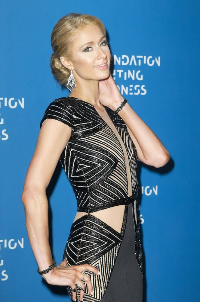 Paris Hilton had her blonde locks arranged into a classic low bun during the Foundation Fighting Blindness Gala at Cipriani 25 Broadway on April 12, 2016. Chandelier earrings and a black geometric dress completed the sleek yet classy look.
