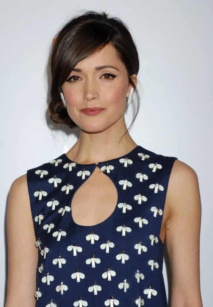 Rose Byrne was at the 2013 GDay USA Los Angeles Black Tie Gala on January 12, 2013, in Los Angeles, CA. She was seen wearing a lovely patterned dress with her dark low bun hairstyle that has loose tendrils.