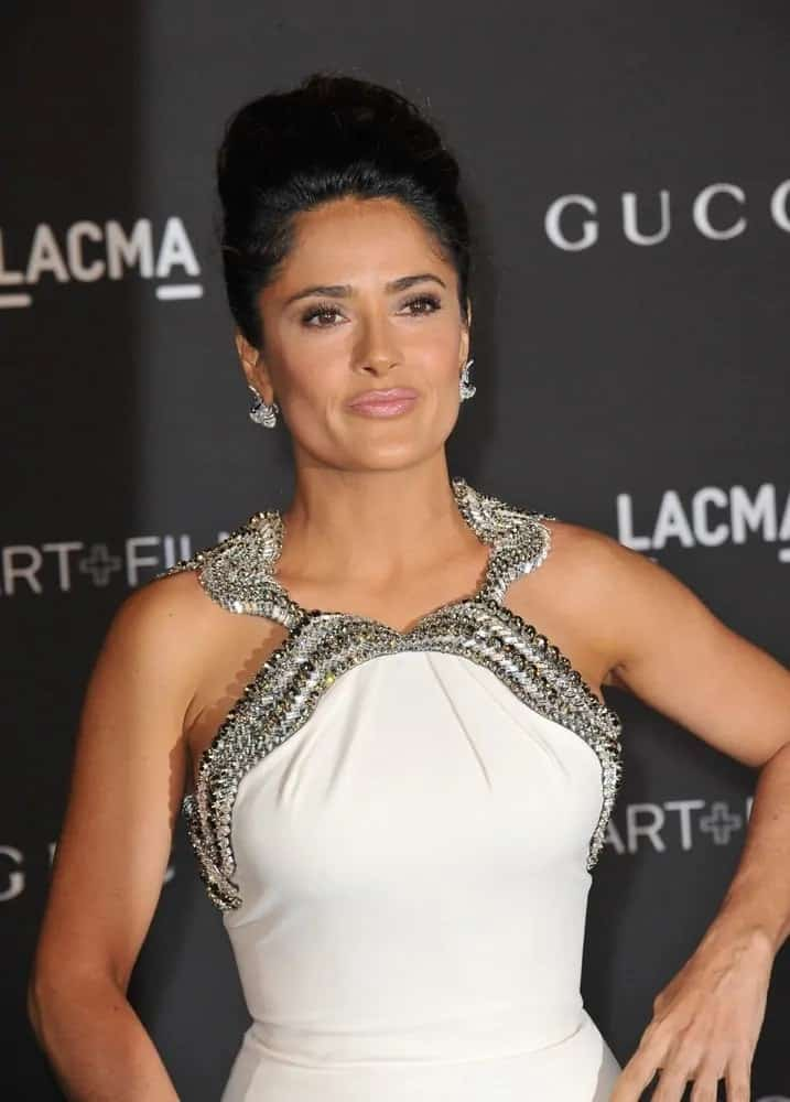 The Mexican beauty had her hair styled into an elegant bun at the 2014 LACMA Art+Film Gala last November 1, 2014. This brings focus on her beautiful earrings and white detailed dress.