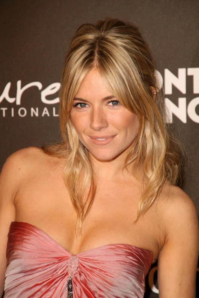 Sienna Miller gathered her blonde locks into a loose half upstyle with curtain bangs during the Montblanc 'Signature for Good' Charity Gala held on February 20, 2009.