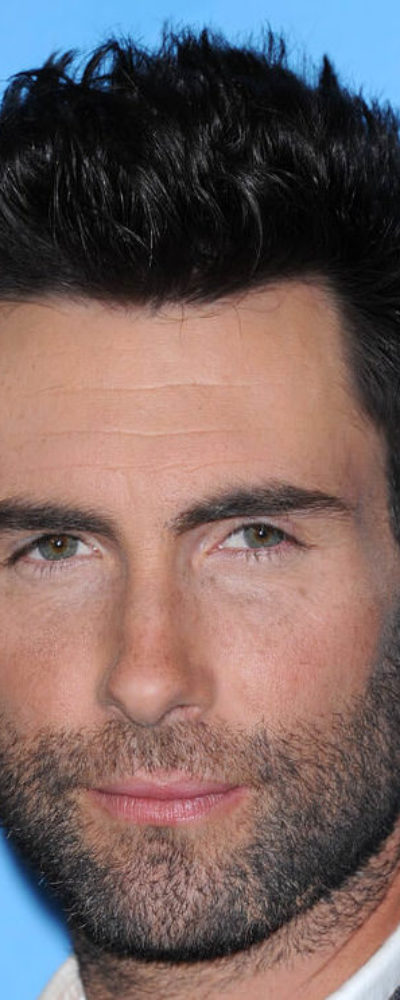 Adam Levine sporting spiked hairstyle