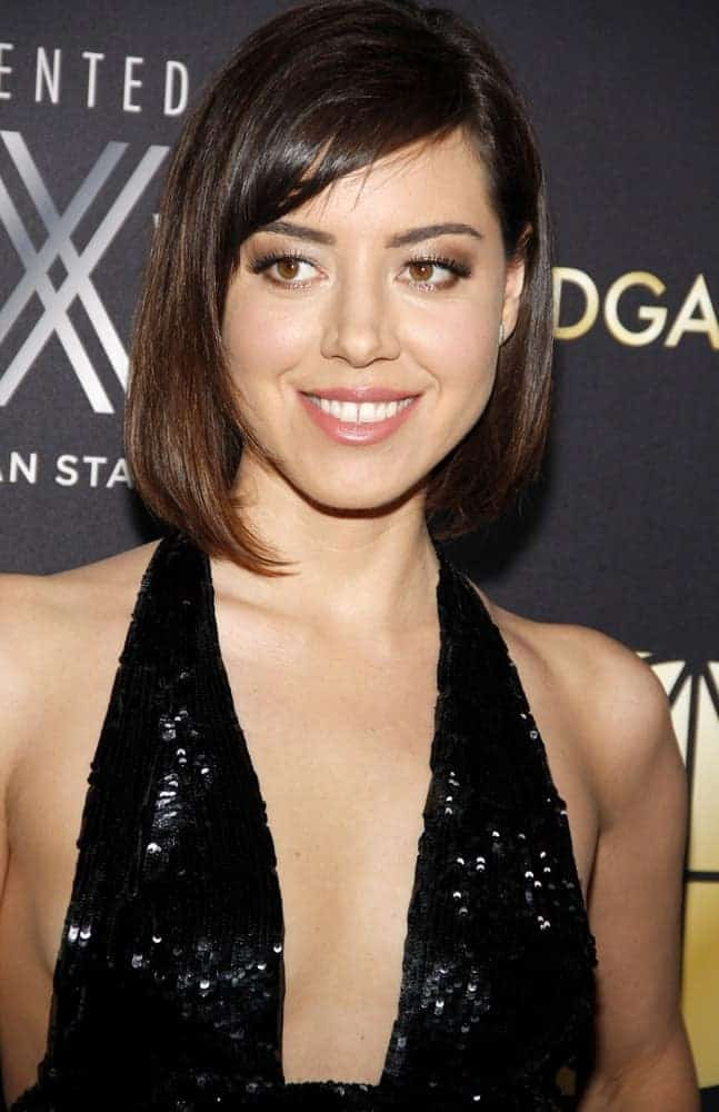 Aubrey Plaza was at the 20th Annual Art Directors Guild Excellence In Production Design Awards held at the Beverly Hilton Hotel in Beverly Hills on January 31, 2016. She paired her sexy black sequined dress with a shoulder-length silky straight bob hairstyle with side-swept bangs.
