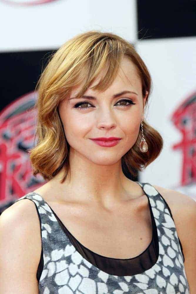 """Christina Ricci was at the Premiere of """"Speed Racer"""" held at the Nokia Theater in Los Angeles, California on April 26, 2008. She was seen wearing a lovely dress with her shoulder-length sandy blonde hairstyle that has large curls and side-swept bangs."""