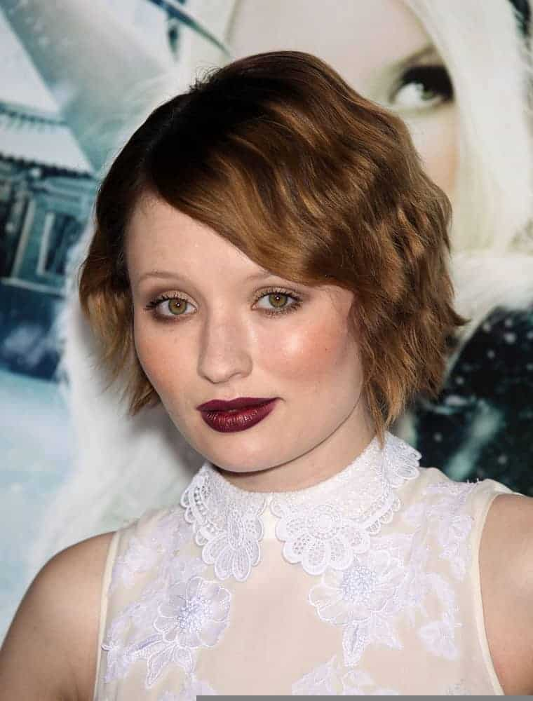 """Emily Browning attended the """"Sucker Punch"""" World Premiere on March 23, 2011, in Hollywood, CA. She was lovely in a white sheer dress and topped it with a pixie brunette hairstyle with curls and long side-swept bangs."""