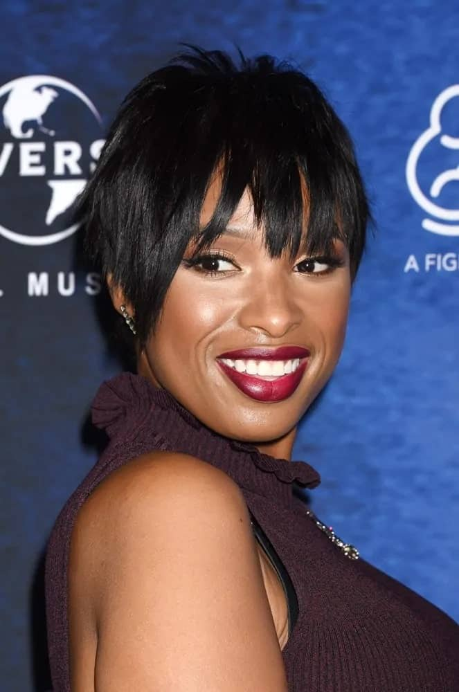 Jennifer Hudson attended the 2016 March of Dimes Celebration of Babies Luncheon on December 9, 2016 in Beverly Hills, CA. She was seen wearing a dark smart casual outfit with her layered and tousled raven pixie hairstyle.