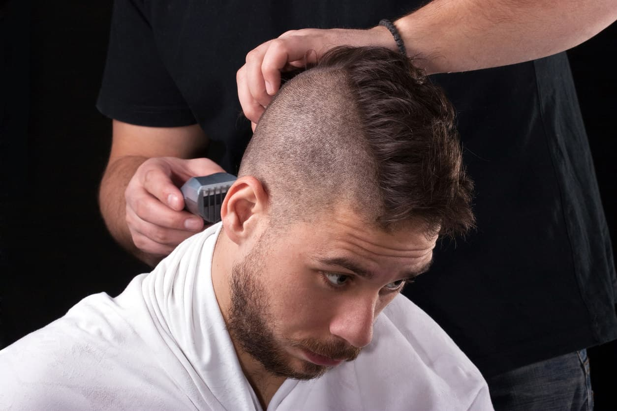 Man getting mohawk style haircut