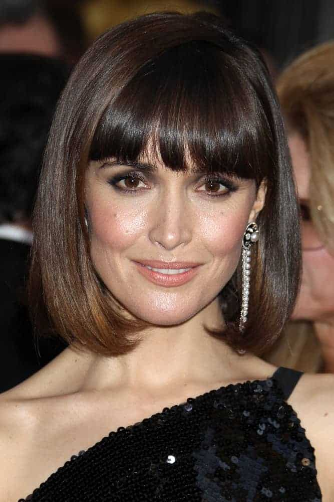 Rose Byrne was at the 84th Academy Awards at the Hollywood & Highland Center on February 26, 2012, in Los Angeles, CA. She wore a black sequined dress with her chin-length straight hairstyle with blunt bangs.