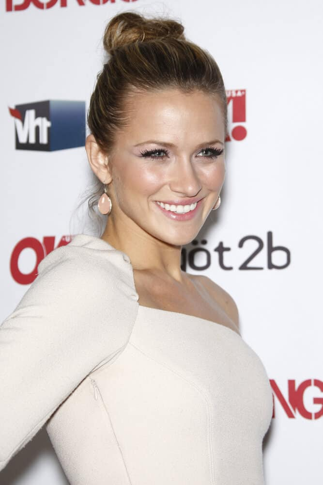 Shantel VanSanten attends a party with this neat high bun.