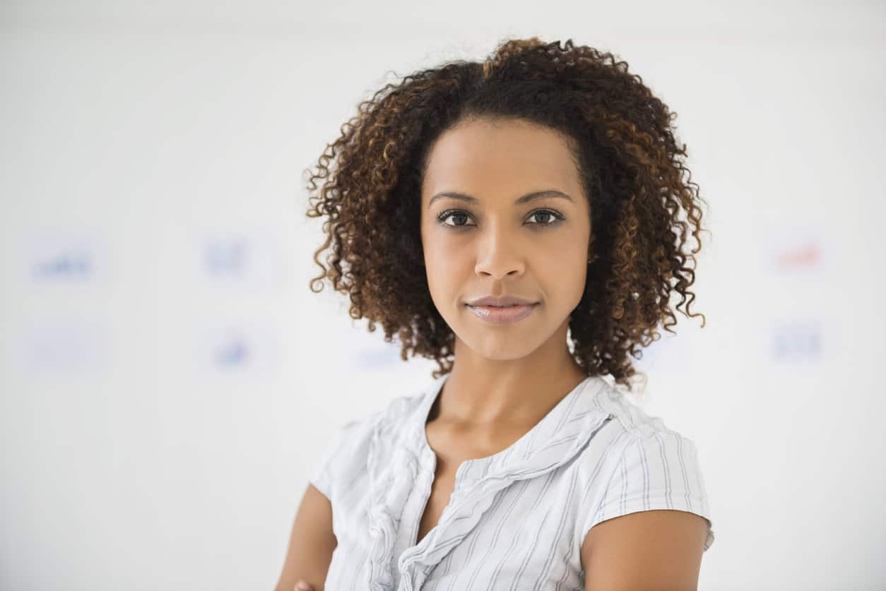 Woman with short, dark curly hair