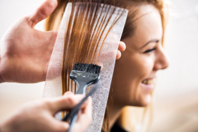 Woman getting highlights put into hair