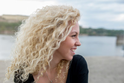 Woman with long blonde curly hair