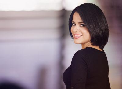 Woman with dark short straight hair