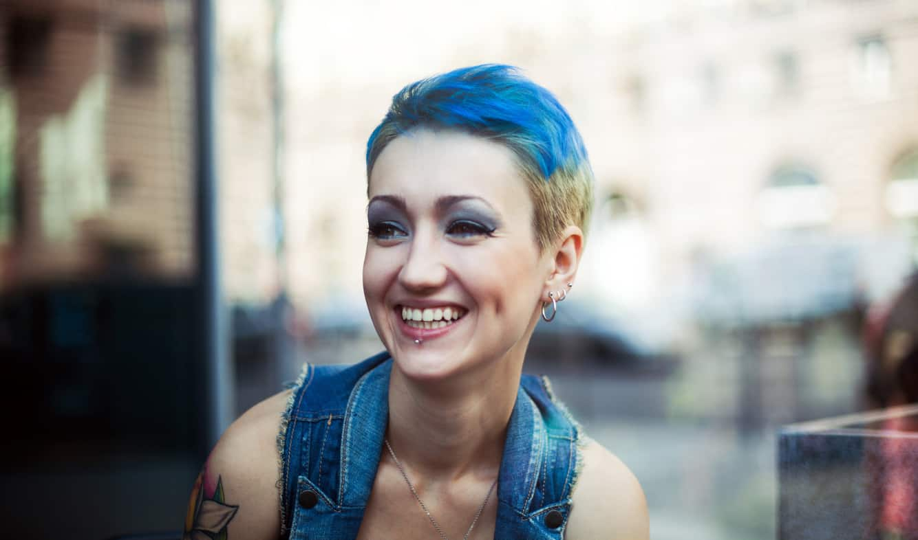 Woman with short blue hair