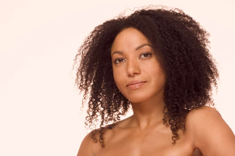 Woman with kinky hair.
