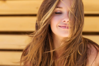 Woman with long light brown hair