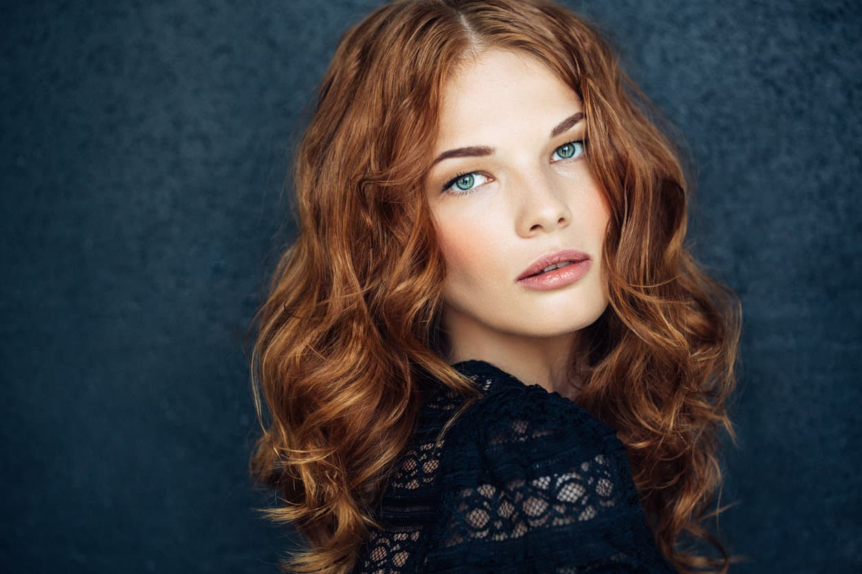 Woman with long wavy red hair