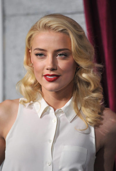 Amber Heard in a curly, retro look.