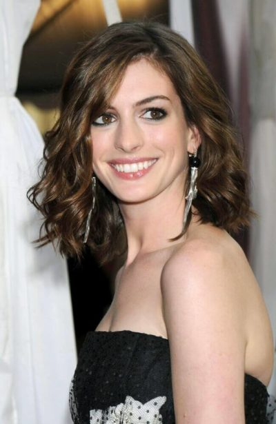 Anne Hathaway's wavy mob giving her a beautiful glow.