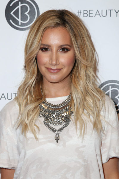 Ashley Tisdale with blonde, beach waves.