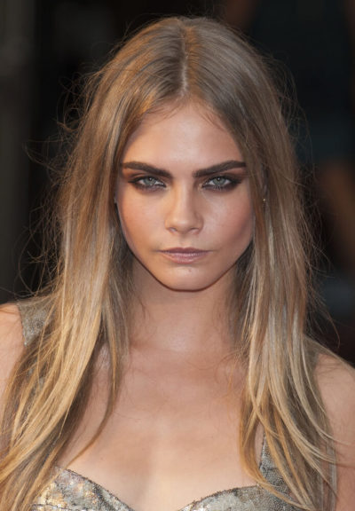 Cara Delevigne looking fierce with her dirty blonde hair.