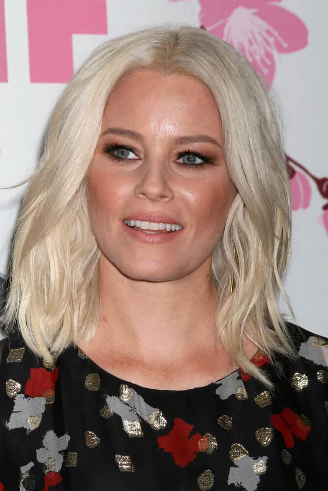 Elizabeth Banks, wavy platinum blonde hair.