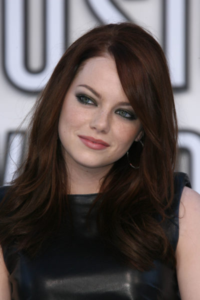 Emma Stone with deep, chestnut brown hair.