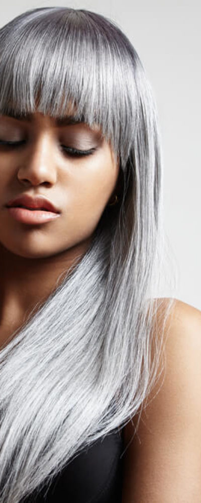 Long hair with full bangs in gray.