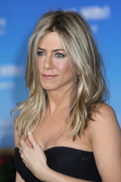 Jennifer Aniston with face-framing, subtle layers.