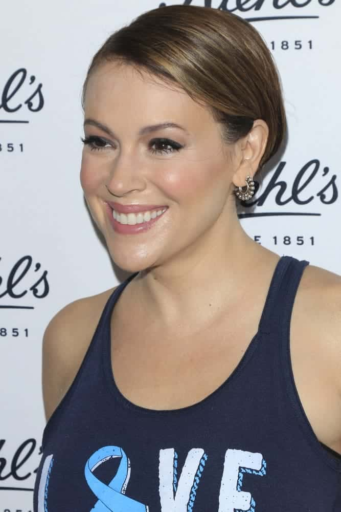 Alyssa Milano with pulled back light brown hair.