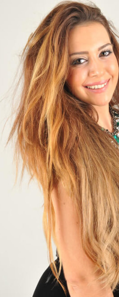 Extra long, layered hair in Blonde.