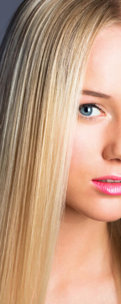 A young model with straight, blonde hair.