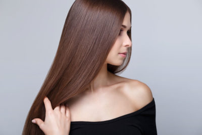 A young woman with long, and stunning straight hair.