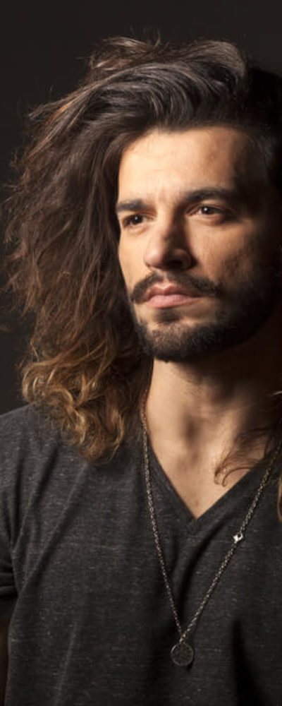 Man with long and thick, wavy hair.