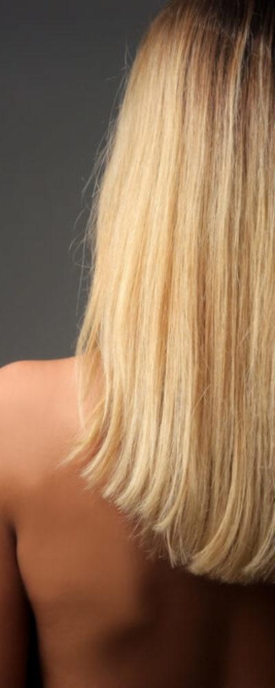 Back view of medium-length, blonde hair.