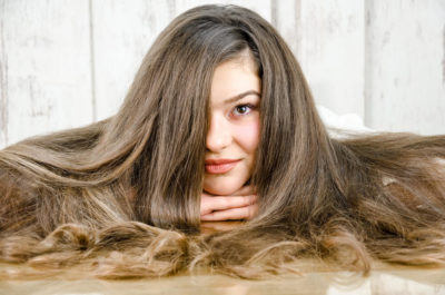 A young woman flaunting her thick and messy hair.
