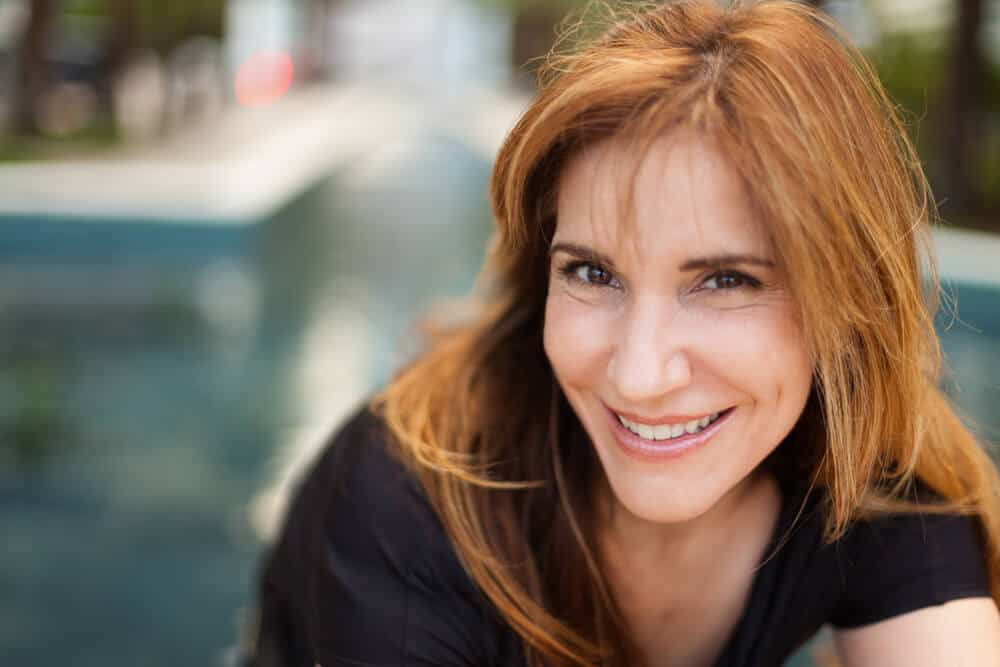 A beautiful middle-aged woman with Auburn hair.