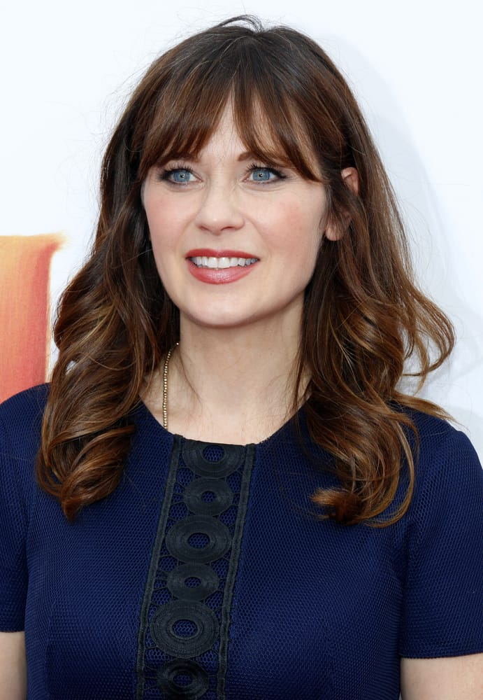 Zooey Deschanel's medium hairstyle with bangs.