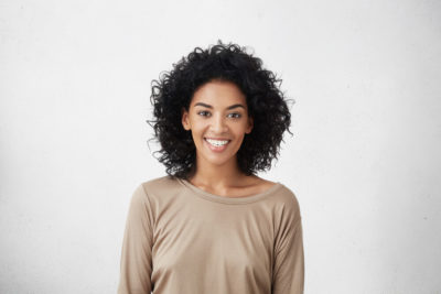 Woman with short, curly hair.