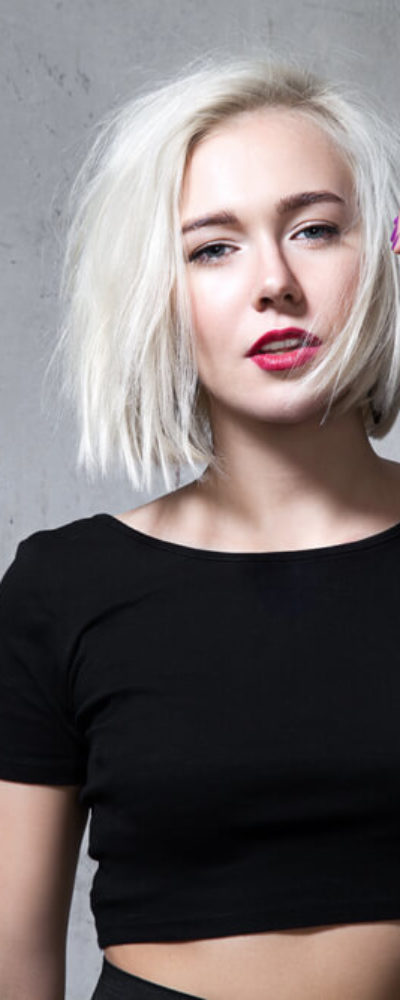 Woman with white, bob cut hairstyle.